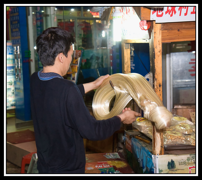 IMAGE: http://rpcrowe.smugmug.com/Other/Yangshuo-a/064-candy-maker/858914936_pX2Gk-L.jpg